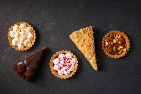 Collection of delicious desserts on gray background, top view Stock fotó