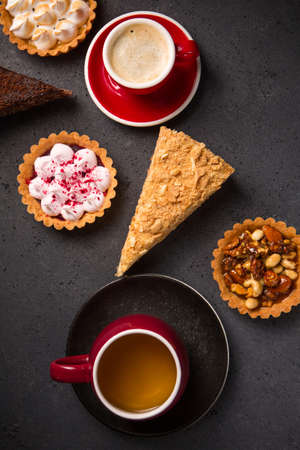 Collection of delicious desserts on gray background, top view Archivio Fotografico