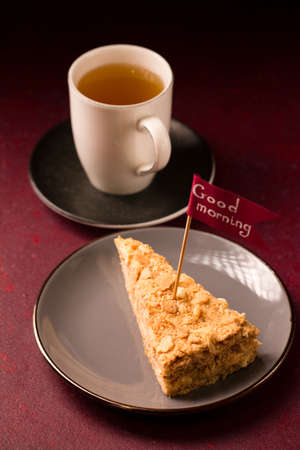 Morning herbal tea with a slice of delicious napoleon cake Stock fotó