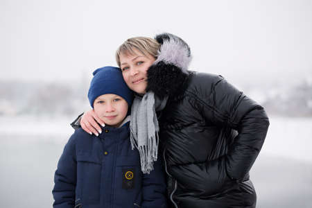 Casual portrait of mom and son in winter 写真素材