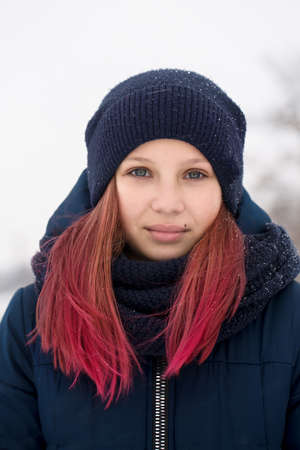 Girl with pink hair wearing a hat
