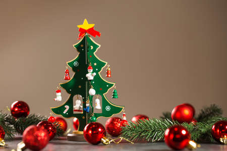 Wooden vintage christmas tree with small wooden toys