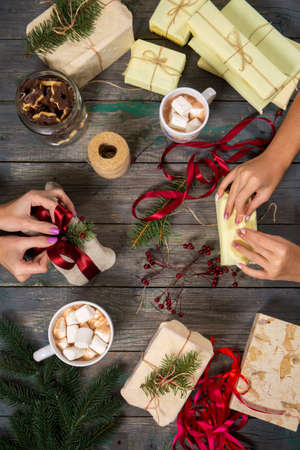 Girls seal gifts and drink cocoa with marshmallows Archivio Fotografico