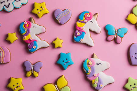 Beautiful, bright, figured gingerbread cookies for the holiday on a pink background
