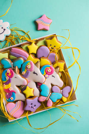 Beautiful, bright, figured gingerbread cookies for the holiday in a gift box on a turquoise background