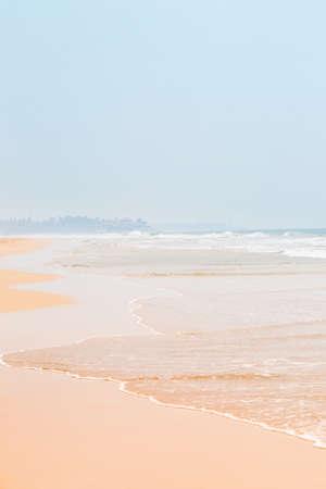 gentle wave on golden sand by the ocean, summer background Archivio Fotografico