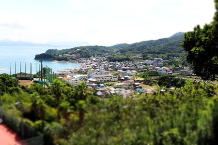 near side: Miniature of town near sea side