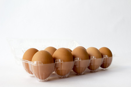 chicken egg: Ten brown chicken eggs in plastic container package; chicken eggs are high protein and suitable for all ages. People who eat will healthy and strong.