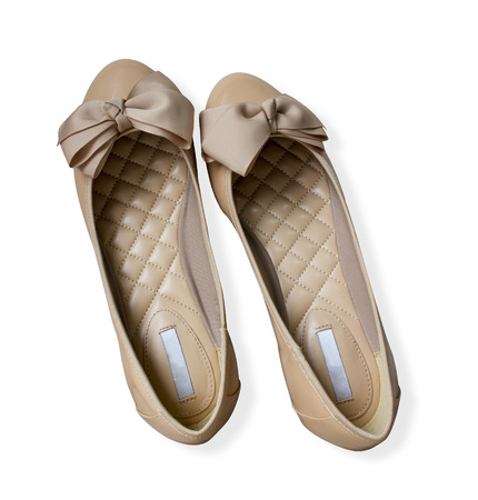 Light brown gloss summer and autumn flat shoes isolated on white background; Beautifu comfortablel glossy brown flat shoe with big ribbon suitable wear to outdoor, party and ceremony wedding. photo