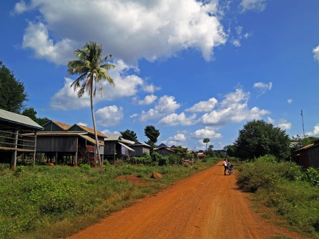 dusty: Cambodian village next to dusty road Stock Photo