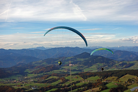 paraglider: paraglider flying high in the sky