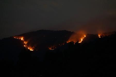 bush fire: Huge bush fire at a mountain in Myanmar