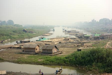 trash the dress: Slum village near the river in the Mandalay city in Myanmar (Burma)