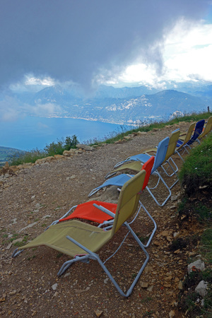 Row of deck chairs on Monte Baldo, Italy