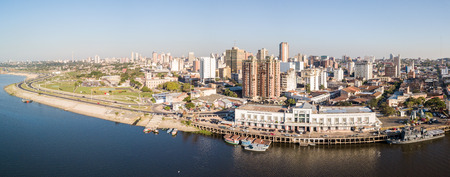 Panoramic view of the skyscrapers skyline of the Latin American capital city of Asuncion Embankment of Paraguay river. Birds eye aerial drone photo. Ciudad de Asunci?n Paraguay.