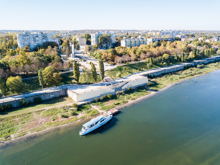 Aerial view of peaceful city center of Bendery (Bender), embarkment of Dniester river with a pleasure boat, in unrecognised Pridnestrovian Moldavian Republic (Transnistria; PMR), officially Moldova