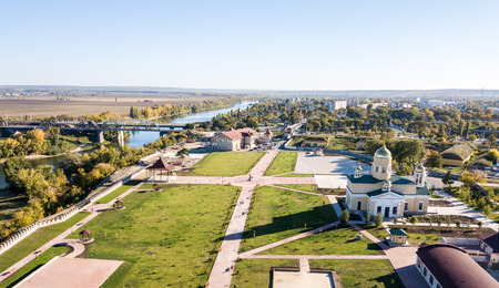 Aerial view of Orthodox cathedral, the Peacekeepers bridge, with Bendery (Bender) city on river of Dniester in background, in Transnistria (Pridnestrovian Moldavian Republic, PMR), officially Moldova