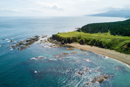 Aerial drone photo of cape Velikan (near by cape Ptichiy), Sakhalin island, Russia (Sahalin). Unbelievable natural green lawns.