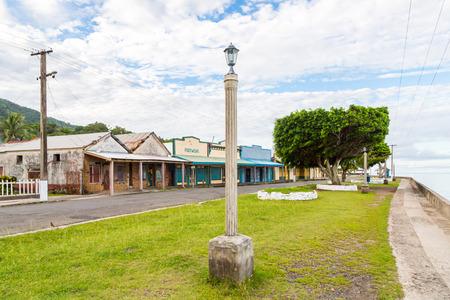 Colourful empty seafront of old colonial capital of Fiji - Levuka town, Ovalau island, Lomaiviti archipelago, Fiji, Melanesia, Oceania, South Pacific Ocean. Street light pole. Imagens