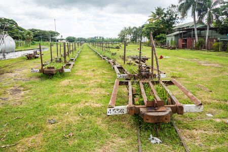 Lautoka, Fiji - Jan 4 2015: Abandoned freight cargo narrow gauge railway station for transporting sugar cane. At Lautoka sugar mill, largest sugar mill in the southern hemisphere. 新聞圖片