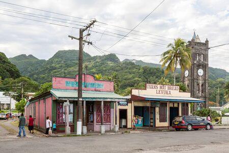 Levuka, Fiji - Jan 9 2015: Colourful vibrant streets of old colonial capital of Fiji: Levuka town, Ovalau island, Lomaiviti archipelago, Melanesia, Oceania, South Pacific Ocean. Church clock tower.