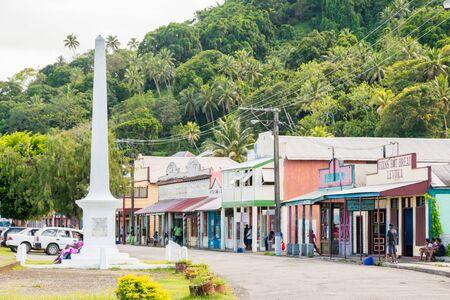 Levuka, Fiji - Jan 9 2015: Colourful vibrant street of old colonial capital of Fiji - Levuka town, Ovalau island, Lomaiviti archipelago, Fiji, Melanesia, Oceania, South Pacific Ocean. Stele, obelisk