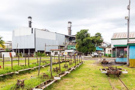 Lautoka, Fiji - Jan 4 2015: Lautoka sugar mill with abandoned narrow gauge railway. The sugar factory est.1903 and is still by all accounts the largest sugar mill in the southern hemisphere.