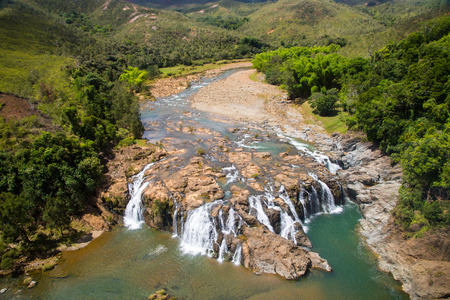 Impressive waterfalls on Koua river aerial view, between Poro and Kouaoua, North Province, New Caledonia, Melanesia, Oceania, overseas territory of France, South Pacific Ocean Banco de Imagens
