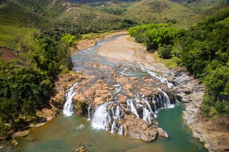 Impressive waterfalls on Koua river aerial view, between Poro and Kouaoua, North Province, New Caledonia, Melanesia, Oceania, overseas territory of France, South Pacific Ocean Archivio Fotografico