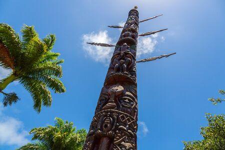 Noumea, New Caledonia - Jan 14 2013: Mwâ Ka (Mwa Ka, Big House or House of Man), monumental 12-meter kanak totem pole erected in city centre Noumea, commemorating French annexation of New Caledonia. Editoriali