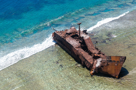 Aerial view of the shipwreck site of 1965 of Motor vessel Ever Prosperity cargo ship from Monrovia, Liberia. West Coast barrier reef, Coral sea, New Caledonia, South Pacific Ocean