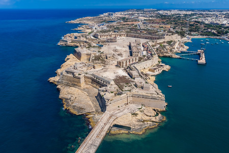 Fort Ricasoli aerial view. Island of Malta from above. Bastioned fort built by the Order of Saint John in Kalkara, Malta. Gallows Point, north shore of Rinella Bay, entrance to the Grand Harbour.