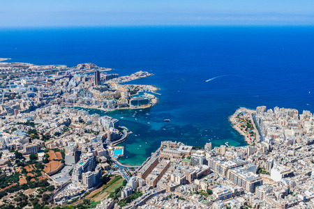 Malta aerial view. St. Julians (San Giljan) and Tas-Sliema cities. St. Julian's bay, Balluta bay, Spinola bay, Towns, harbours and coastline of Malta from above. Skyscraper in Paceville district