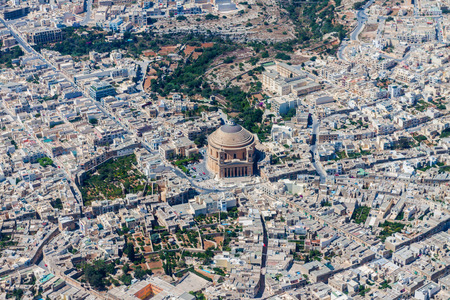 Famous Mosta Dome (Rotunda of Mosta, The Basilica of the Assumption of Our Lady Mary) aerial view. Roman Catholic parish church and Minor Basilica in Mosta, Malta. Malta from above Banco de Imagens