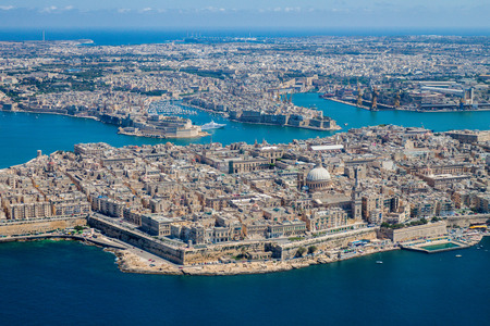 Malta aerial view. Valetta, capital city of Malta, Grand Harbour, Senglea and Il-Birgu (Vittoriosa) towns, Fort Ricasoli and Fort Saint Elmo from above. Marsaxlokk city and Freeport in background Banco de Imagens