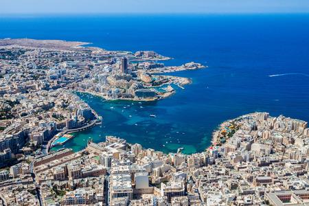 Malta aerial view. St. Julian's (San Giljan) and Tas-Sliema cities. St. Julian's bay, Balluta bay, Spinola bay, Towns, harbours and coastline of Malta from above. Skyscraper in Paceville district Archivio Fotografico
