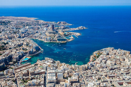 Malta aerial view. St. Julian's (San Giljan) and Tas-Sliema cities. St. Julian's bay, Balluta bay, Spinola bay, Towns, harbours and coastline of Malta from above. Skyscraper in Paceville district Imagens