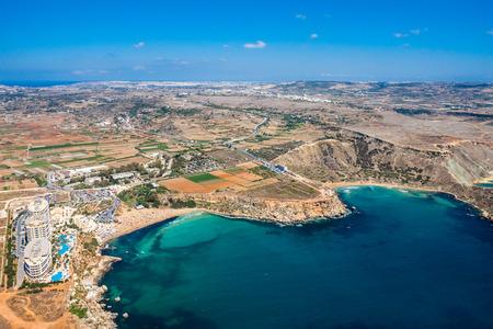 Aerial view of Golden bay beach, Ghajn Tuffieha (Għajn Tuffieħa) bay. Mellieha (Il-Mellieħa), Northern Region, Malta island. Malta from above.