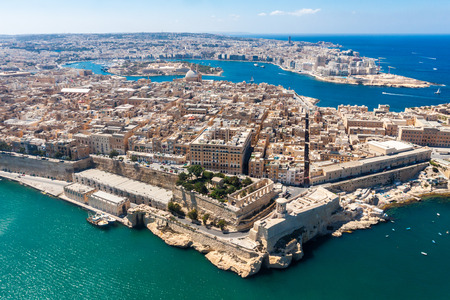 Historical Valetta, capital city of Malta, Grand harbour, Gzira and Sliema towns, Manoel Island in Marsamxett bay from above. Skyscraper in Paceville district is in the background. Malta aerial view
