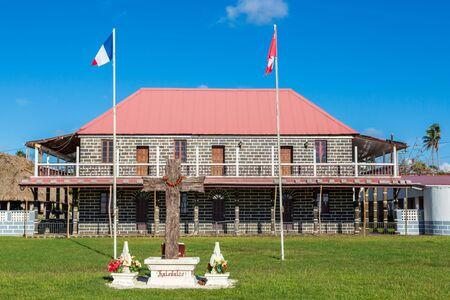 Mata-Utu, Wallis and Futuna - Jan 5 2013: Customary King's Palace in the capital of territory of Wallis-et-Futuna, French overseas island collectivity. Two flags flying - French and Wallis and Futunes