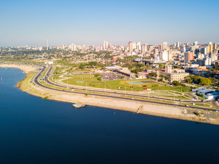 Panoramic view of skyscrapers skyline of Latin American capital of Asuncion city, Paraguay. Embankment of Paraguay river. Birds eye aerial drone photo. Ciudad de Asuncion Paraguay. South America. Фото со стока