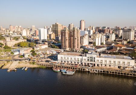 ASUNCION, PARAGUAY - July 13, 2018: Panoramic view of skyscrapers skyline of Latin American capital of Ciudad de Asuncion Paraguay and Embankment of Paraguay river as seen in aerial drone photo