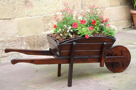 lovely wheelbarrow with flowers very creative and original