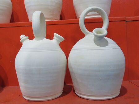 Beautiful earthenware pitchers of mud typical of Spain to drink fresh water Imagens