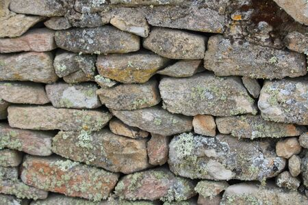 Beautiful stone wall, hand-made and very old Stock Photo