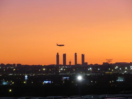 Beautiful photo of a plane landing at the airport in Madrid Spain
