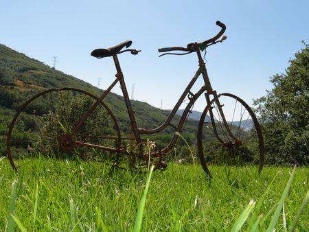 Beautiful photo of a rusty old bicycle and abused