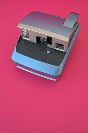 Blue Camera over Pink Background Stock Photo - 504196