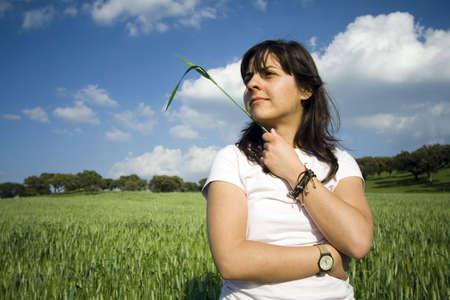 woman in spring with straw in her hand Stock Photo - 1172255
