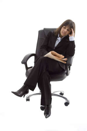 demotivated: Businesswoman siting in chair with headache isolated on white